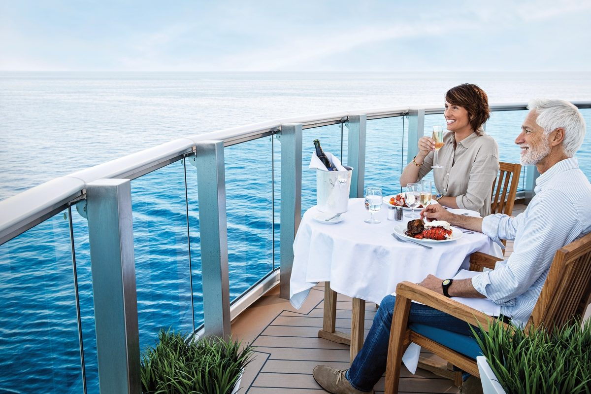Two people eating on balcony of cruise ship