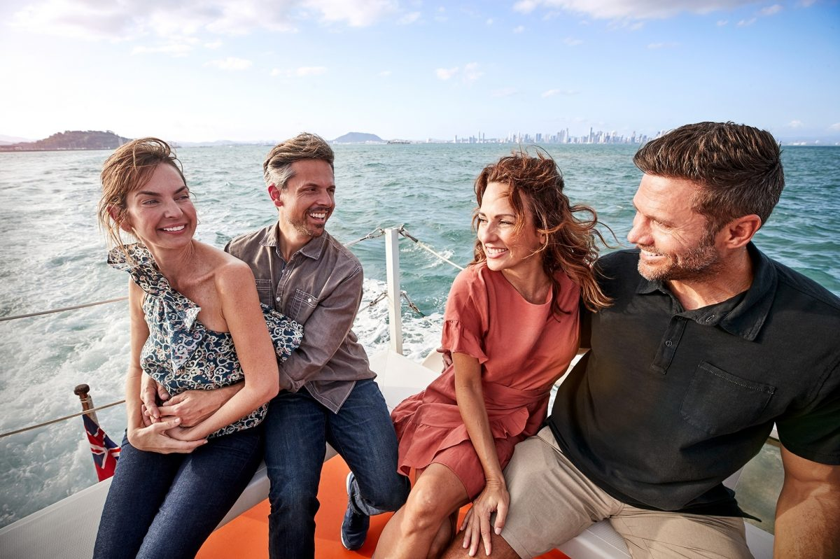 Friends on a speedboat in South America
