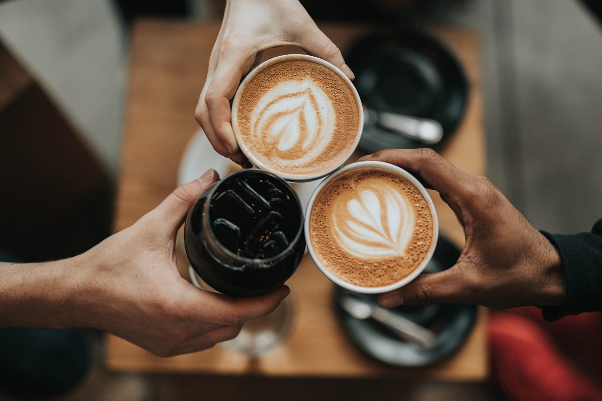Three people holding cofee