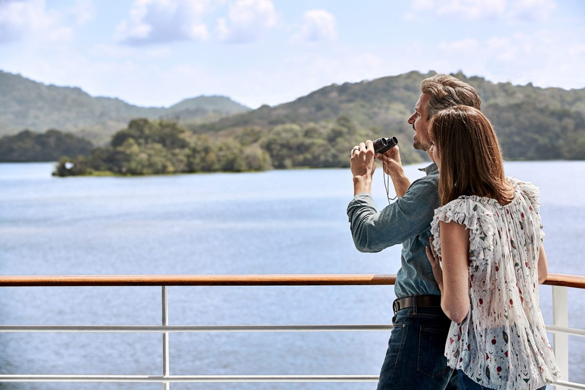 Couple looking out onto Panama canal