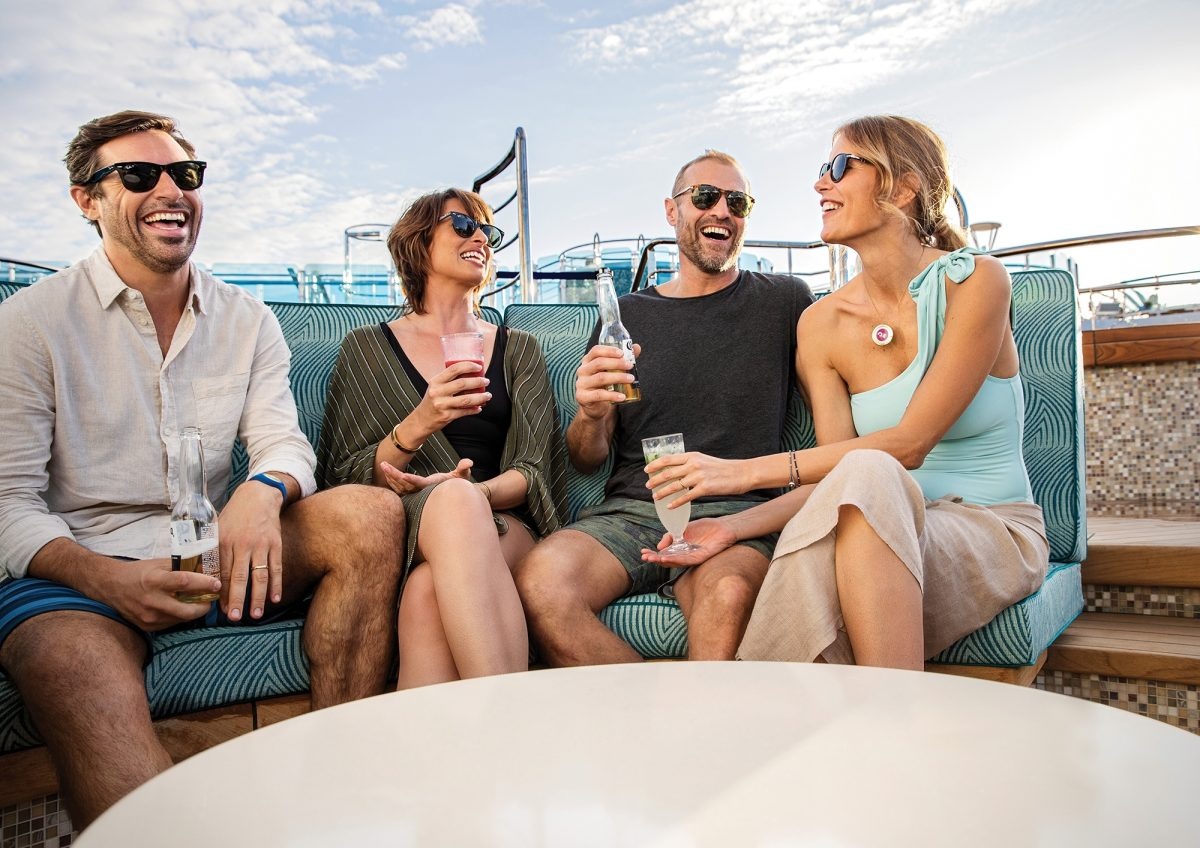 Four friends drinking cocktails