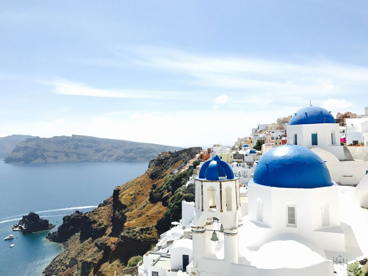 A view over Santorini featuring blue domes and sea