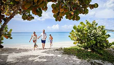 A family running on a Caribbean beach