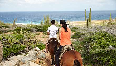 Couple horseriding in Aruba