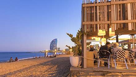 People eating at beachside restaurant in Barcelona