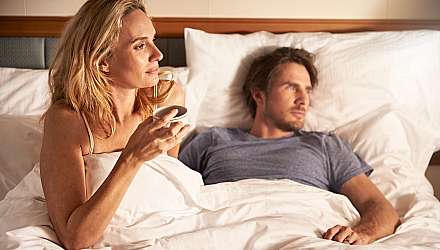 Couple In Bed with coffee