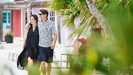 A couple walking through Princess Cays in the Caribbean