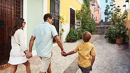 Family of 3 walking down street