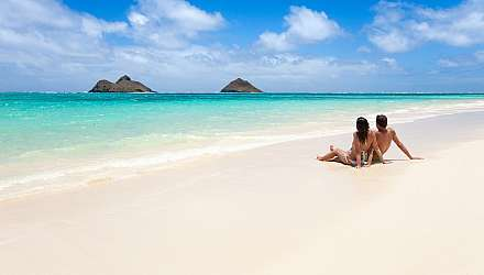 Romantic couple on a tropical beach in Oahu, Hawaii.