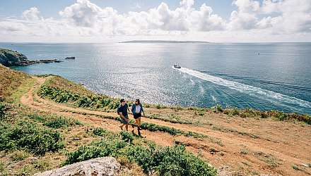 Couple walking on Herm Island