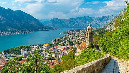 View over water and Chapel of Our Lady of Salvation overlooking the Old Town, UNESCO World Heritage Site, Kotor, Montenegro