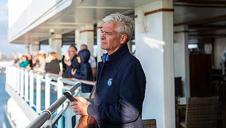 Phillip Schofield wearing a Princess Ocean Medallion onboard Regal Princess
