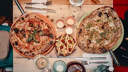 A table with two pizzas