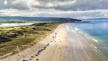 Portstewart Strand with golf course in distance