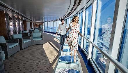 Two people walking on glass floor in ship