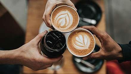 Three people holding cofee